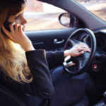 Lady on a cell phone while driving