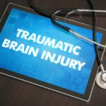 Ipad that reads Traumatic brain injury