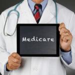 Dr. holding a Medicare sign