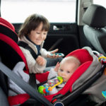 Child car seat guidelines recommend rear facing car seats as shown in picture