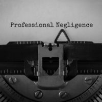 Text Professional Negligence typed on retro typewriter