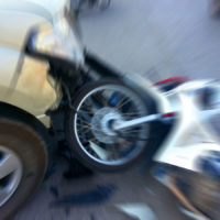 Pickup in the midst of crash with motorcycle on the road
