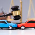 Two Cars On Desk In Courtroom