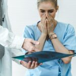 Doctor and unhappy patient at hospital or medical clinic